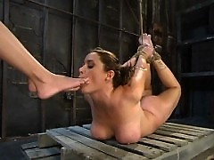 This busty girl can take some real pain and bondage.
